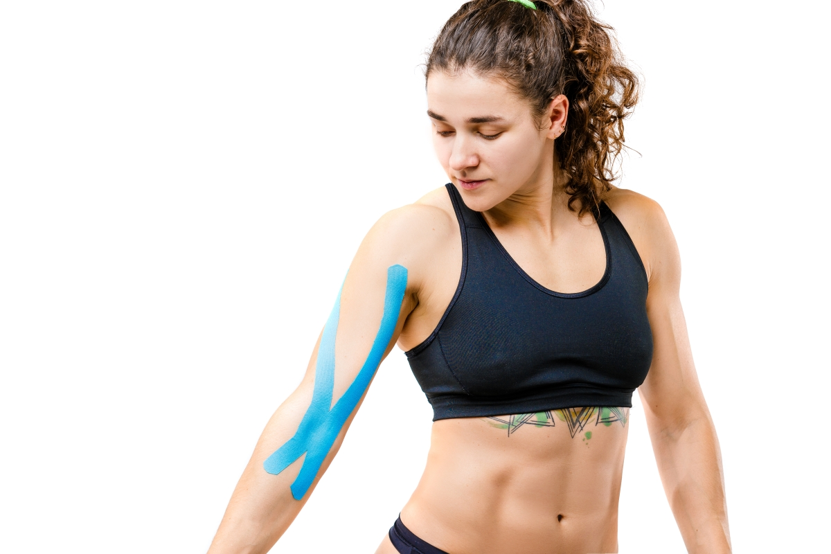 young woman with blue kinesio tape on arm