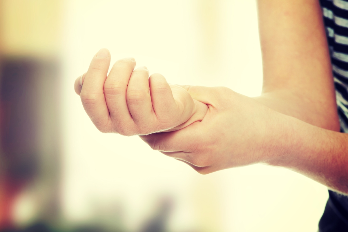 Woman holding her wrist -