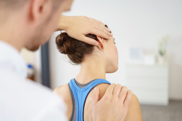 an-in-home-physical-therapist-working-on-a-clients-neck