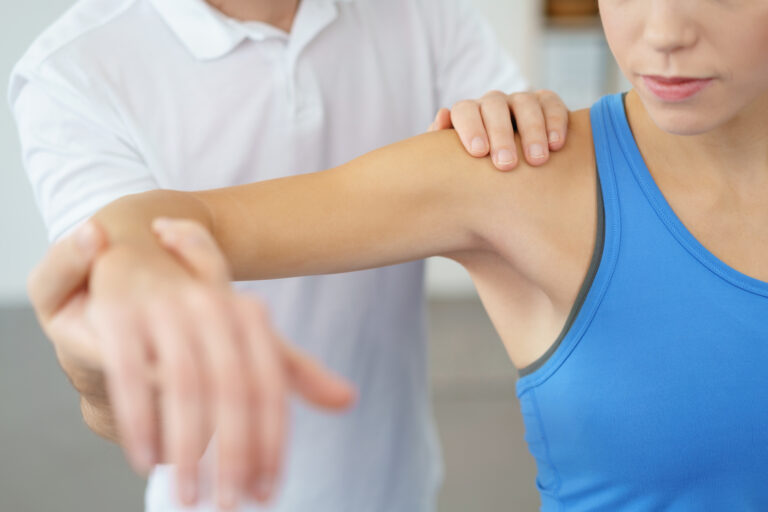 an-in-home-physical-therapist-working-on-a-patients-arm