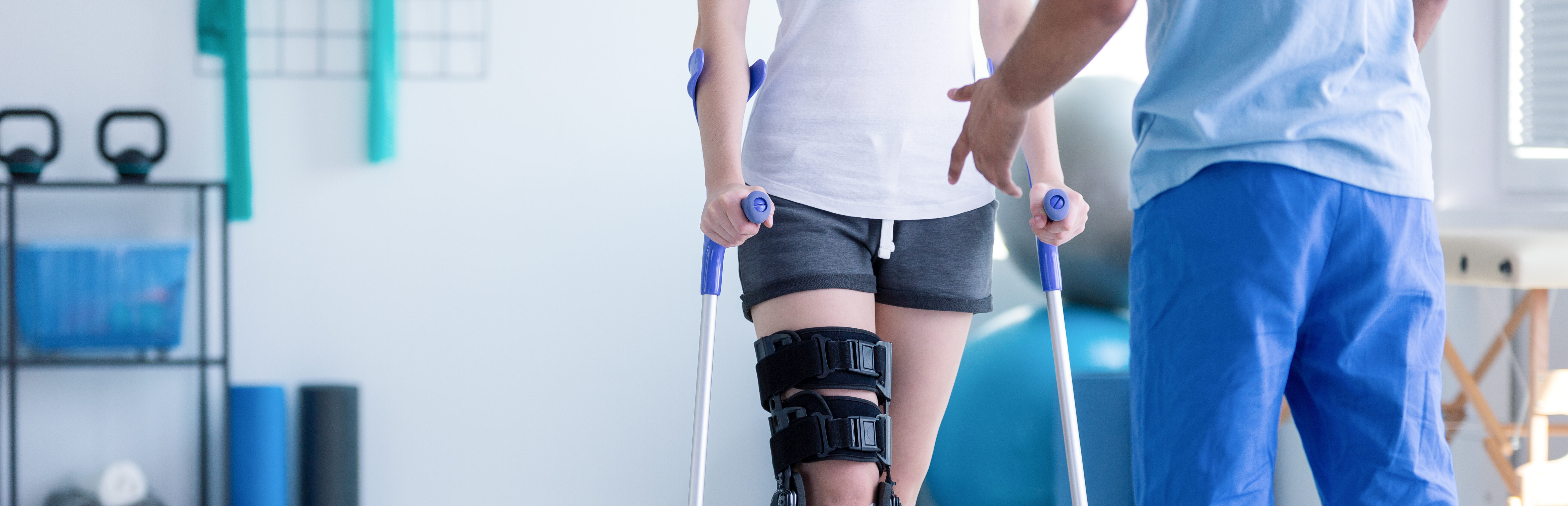 an-in-home-physio-therapist-helping-a-patient-walk-with-a-brace
