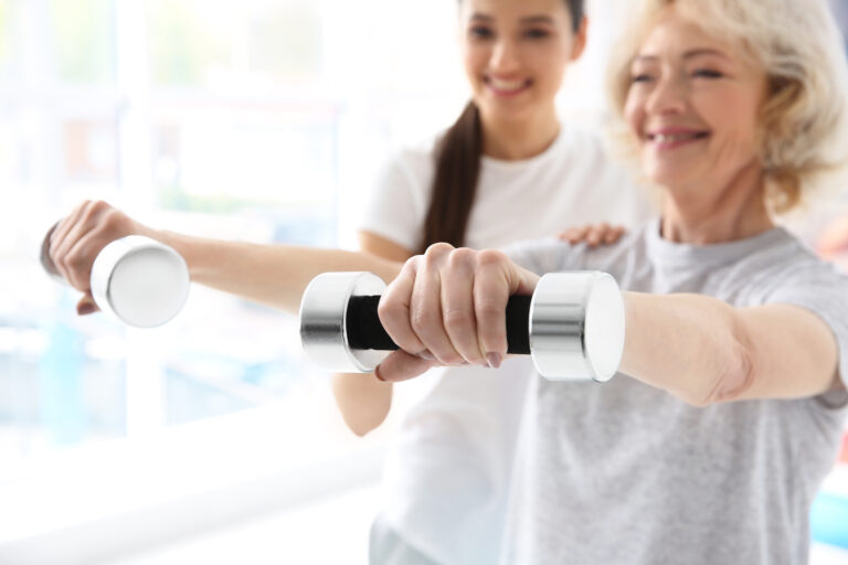 in-home-physical-therapist-helping-their-patient-use-free-weights