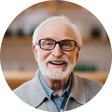 older-man-with-glasses-and-a-beard-smiling-at-the-camera